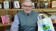 Read-ability volunteer with home delivery bag